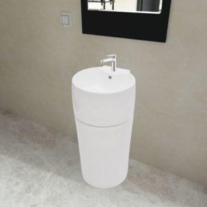Valge ümar keraamiline aluse peal valamu vannituppa