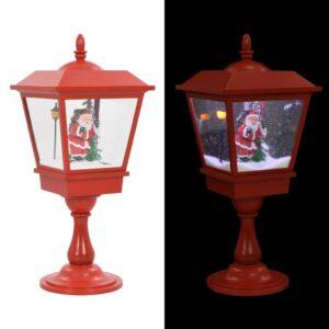 alusel jõululamp jõuluvanaga